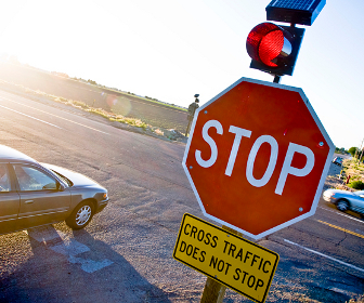 An intersection controlled by a stop sign